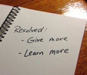 "Handwritten message: ""Resolved: Give more, Learn more"""